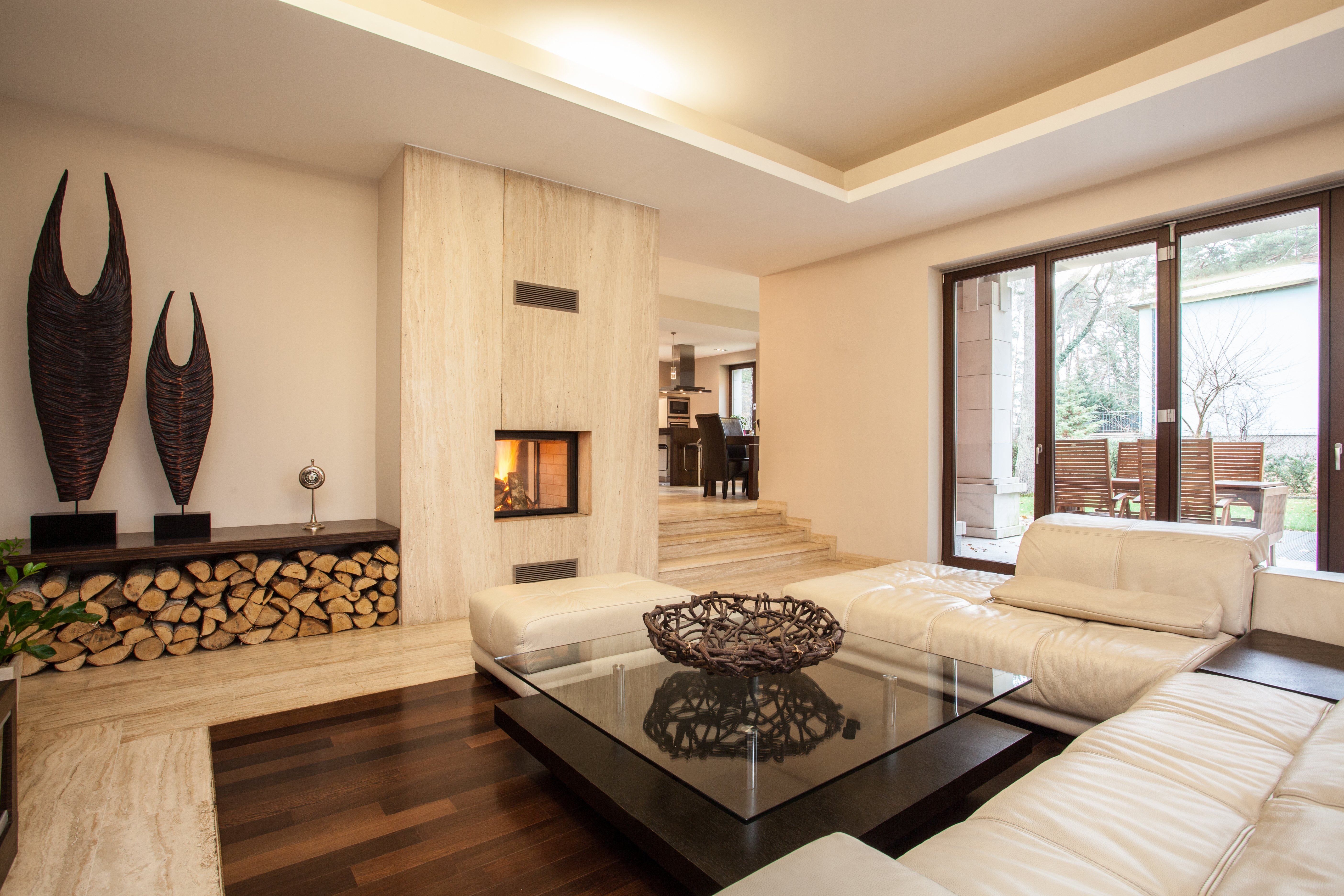 Travertine house: interior of beige living room